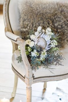 Beautiful bridal bouquet for a vintage winter wedding! By Milwaukee Flower Company and photographed by Twin Lens Weddings #bouquet #weddingbouquet #bridalbouquet #winterwedding #weddinginspiration #twinlensweddings