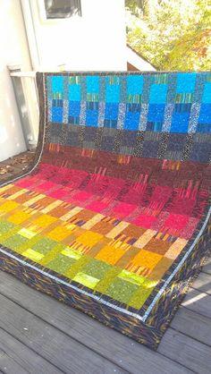 Gideon's quilt, pattern Garden Rainbow Quilt by Kaffe Fassett.