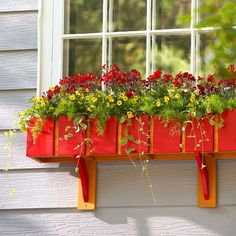 DIY Window Box  Build a wood window box that adds interest to your home's exterior and holds a variety of plant containers.  How-to tips make it easy.