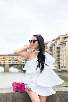 Embracing the white and pink color combination in my ruffle off the shoulder top and lush rose purse. Tiered ruffles with a peekaboo shoulder, and white mules to complete the look.