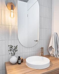 Planning a powder room? have paired the Albert Park Matt Vanilla tile with a timber vanity with tapware. Timber Vanity, Splashback, Subway Tiles Bathroom, Round Mirror Bathroom, Bathroom, Bathroom Renovations, Downstairs Bathroom, Bathrooms Remodel, Bathroom Inspiration