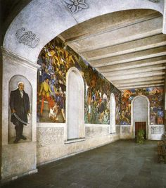 Inside the Palacio de Cortes, Cuernavaca.  These are the murals of Diego Rivera.  There are more back behind this picture.  He depicts the history of Mexico along the walls beginning with the great Aztec empire.