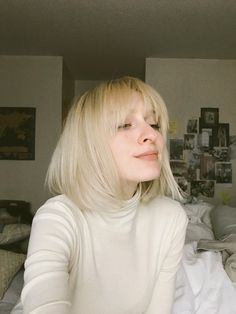 Short blonde hair. 70s bangs.
