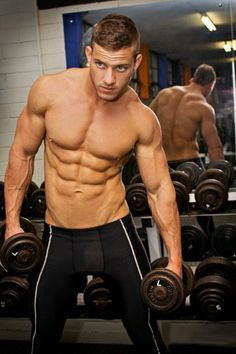 Shirtless jacked unidentified gym and fitness model with a perfect torso and 6pack