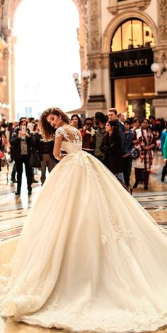 30 Ball Gown Wedding Dresses Fit For A Queen ❤ ball gown wedding dresses lace ivory lace illusion backless with sleeves voguessposa ❤ See more: http://www.weddingforward.com/ball-gown-wedding-dresses/ #weddingforward #wedding #bride