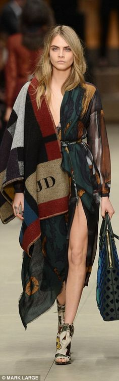 Cara Delevigne on the runway at the Burberry Prorsum autumn/winter 2014/15 collection  shown at London Fashion Week