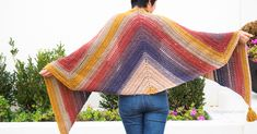 Free pattern to make this simple Adirondack Wrap. Lion Brand Mandala yarn provides gorgeous colors and beautiful drape, perfect as a wrap or super scarf.