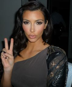 Love Kim's lashes and amazing under eye highlight. Gorg!