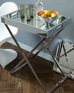 Mirrored tray + brass base - WE $300 (corner where couches meet) *need to check height of sofa.