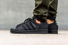 """adidas Originals is back with another Superstar Weave, following the release of the woven shell toe's """"Clear Grey"""" colorway with a """"Core Black"""" take on the iconic low-top. Ditching the previous releas..."""