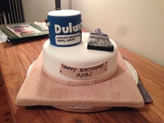 Cake for a painter with fondant paint pot and paint brush