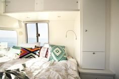 Closest or cabinets to the side of bed...storage above and below bed