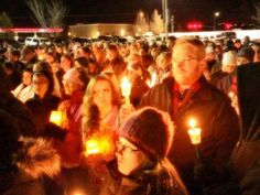 Wife of slain officer speaks of forgiveness at candlelight vigil