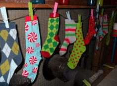 Crafting Occurs: Grinch and Whoville Decorating 101 - would be easy to replicate with Target $ socks - also has cute candy garland - could do with boxes and firsbees in colored celophane