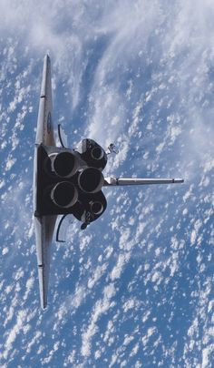 """humanoidhistory:  August 10, 2007 – The Space Shuttle Endeavour performs a """"rendezvous pitch maneuver"""" prior docking with the International Space Station.(NASA)"""