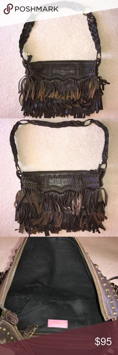 Betsey Johnson  leather fringe Brown handbag Gently used Betsey Johnson dark brown fringe handbag bronze colored hardware and studs this bag has three tears of fringes all the way around braided Crossbody strap Great clean condition except the one strap on the side of bag is missing a couple studs please see pic , The missing studs do not affect the strength of The strap at all, this is a  very sturdy and solid bag from a smoke and pet free home The bag measures 15 inches laying flat across…
