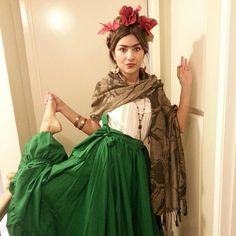 What You'll Need: A white shirt, a green maxi skirt, a tan scarf, and red flowers in your hair. Don't forge...