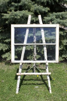 Window with birch easel for a beautiful seating chart or saying. (also available w/o glass) www.southerncharmvintagerentals.com