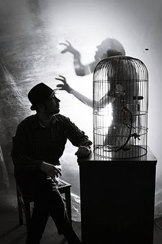 Creepy humanoid shadow emerging from small cage Arte Obscura, Halloween Pictures, Story Inspiration, Dark Art, Black And White Photography, Dark Side, The Darkest, Monochrome, Creepy