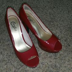 Candies red heels They are red heel by candies. They have been worn 2 times and a look good. They is a small scuff on top by toe where the leather came off. Size of pin tip or smaller. I was just going to use red marker on it and u would never see it. I barely wore them so not sure how it got there.  Couple other scuff marks but not noticeable and it didn't scarce the color off. Probably would buff out with shoe cleaner. Candie's Shoes Heels