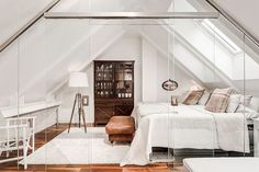 Stunning attic bedroom with glass walls – Explore this attic apartment