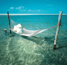 hope I live near the ocean one day. this will be my backyard hammock...