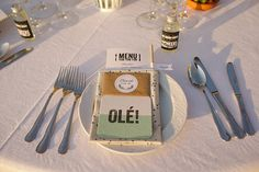 Ole! Spanish wedding stationery/paper table decor.  From 'A Bougainvillea and Olive Leaf Floral Crown For a Fun And Colourful Spanish Fiesta Wedding'.