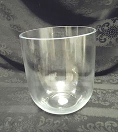 "BDSH S405: tulip-shaped crystal vase. $10.95.   Aprx. 6"" h. x 5"" w.   Perfect for dry or fresh arrangements, creating fruit-filled centerpieces, etc.   LED-type candles, or floating candles."