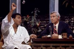 Johnny Carson listens to Ali on the Tonight Show three days before his rematch with Norton. Ali woul... - Neil Leifer for Sports Illustrated