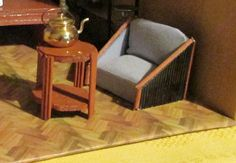 Poirot s armchair, I m afraid there is no place for sofa in this style :-(