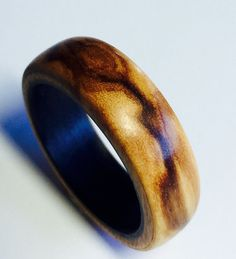 wood ring Olive wood with carbon fiber sleeve by WOODintheHOOD