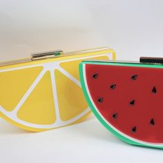 """Lemon clutch Fresh out of the market, this eye-catching lucite clutch will give your outfit a pop of color and fun. This clutch from Spanish-brand Kling comes with a a cute little racket keychain and golden 47″ chain to convert into a shoulder bag. 8.5"""" width x 4.5″ height x 3″ depth Kling Bags"""