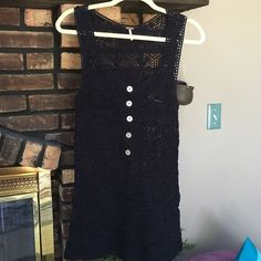 "Free People black crochet tank/tunic Free People black crochet tank/tunic with beautifully detailed buttons partially down the front. Total length is 31"". EUC, no pulls, holes, stains, or damage. Make me a reasonable offer or bundle for a discount! ☮❤️✌️ Free People Tops"