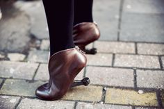 Reverse heeled leather booties.