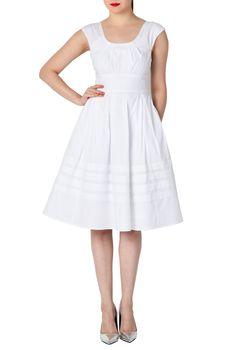 Pretty pleats detail the scooped neck of our cotton poplin dress, box-pleated and nipped in at the waist for a figure-flattering silhouette, and finished with pintucked pleat tiers at the hem.