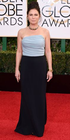 Maura Tierney in a blue and black gown