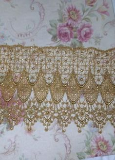 This is for 1yd of the Most STUNNING light gold Metallic trim...The $5.99 price is for 1 yd. ...It is a medium weight..Very open and lacy...Has a