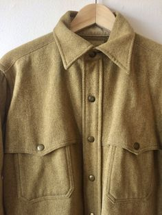 This is a classic vintage 60s LLBean Wool overshirt / jacket in mustard yellow/tan with unique snap details and western styling. The label reads The American Way with Wool: Fabric made in the U.S.A.. Metal snaps. Material: 100% Wool SIze: Marked Mens large. Condition: Very good. Some slight vintage wear. Please read our Shop Policies before purchasing: http://www.etsy.com/shop/flickaochpojke/policy?ref=shopinfo_policies_leftnav Back to our shop: htt...