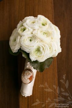 Anna and Spencer Photography, Bride's White Ranunculus Wedding Bouquet with Cameo Detail by Darryl Wiseman in Atlanta.