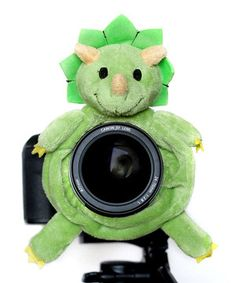 """Cajoling and pleading for little ones to look at the camera will be no more with this clever Shutter Hugger. The fun plush animal """"hugs"""" the lens, so hands are free to stabilize the camera, and it gives photogenic darlings something entertaining to focus on. Capture every precious moment with the help of this friendly pal!"""