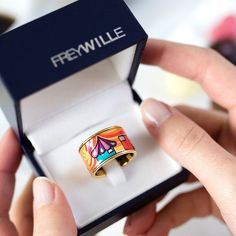 "FREYWILLE Official on Instagram: ""Little dark blue boxes full of colourful shine for this year's Valentine's Day! Seen here: Hommage à Hundertwasser, design 'Imperial' Diva…"" Color Pairing, Blue Box, Check It Out, Class Ring, Diva, Dark Blue, Boxes, Valentines, Pure Products"