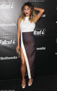 Chrissy Teigen wearing Solace London Nicks Skirt and Casadei Blade Sheer Pumps