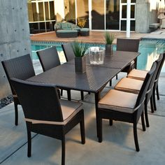Resin wicker outdoor dining sets like this one go with a number of styles from modern to classic. Available for $1599 from Patio Furniture USA.