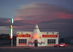 I arrive in Tucumcari just as the sun slips behind the horizon. This town is like a wormhole - Perfect for those who wish to travel back in time. I walk up and down the 66 strip and plant myself in front of this beloved shop. I peek through my viewfinder when an unexpected Corvette pulls in. I couldn't ask for a better photo-bomb. This kind of magic only happens here. • @inter_disciplinary takeover The Mother Road Series #onassignment #route66 #tucumcari #newmexico #americana #roadtrip…