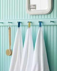 Color-Coded Towel Tags - Your family and guests won't confuse their white towels if you color-code them with hanging loops. Suspended from pegs, the towels will dry quickly and stay neat.