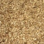 Hardwood Chips. Made up of ground up wood and has a pale wood colour. As a ground cover for gardens. Helps to hold moisture. Applied to a depth of 2 – 3 inches.  Landscape and gardening materials delivered right to your door!!