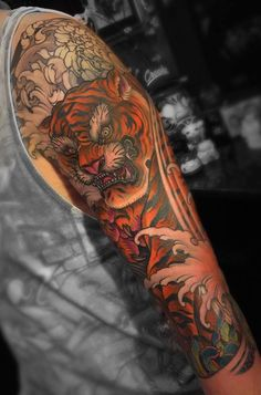 What are the Traditional Japanese Tattoo Meanings? Japanese Tiger Tattoo, Japanese Tattoo Symbols, Japanese Tattoo Designs, Japanese Sleeve Tattoos, Best Sleeve Tattoos, Mens Tiger Tattoo, Tiger Tattoo Sleeve, Traditional Japanese Tattoo Meanings, Asian Tattoos