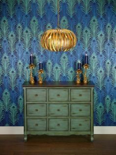 if you love peacocks... Osbourne & Little wallpaper available through  http://www.threetreesinteriors.com