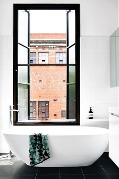 white walls, black floor, black window frame