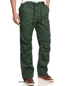 Safari style hits the streets with these casual and cool pants from Sean John. | Cotton | Machine washable | Imported | Men's pants by Sean John  | Drawsrtring and zip closure; 5 pockets in front | We